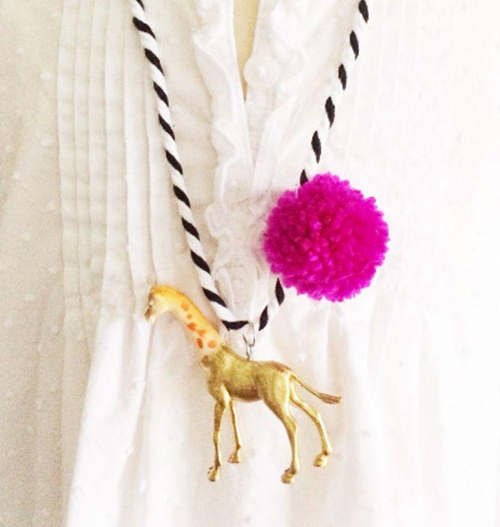 Giraffe Pompom Necklace in Berry