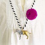 Zebra Pompom Necklace in Berry
