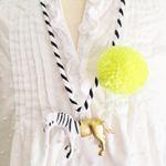 Zebra Pompom Necklace in Yellow