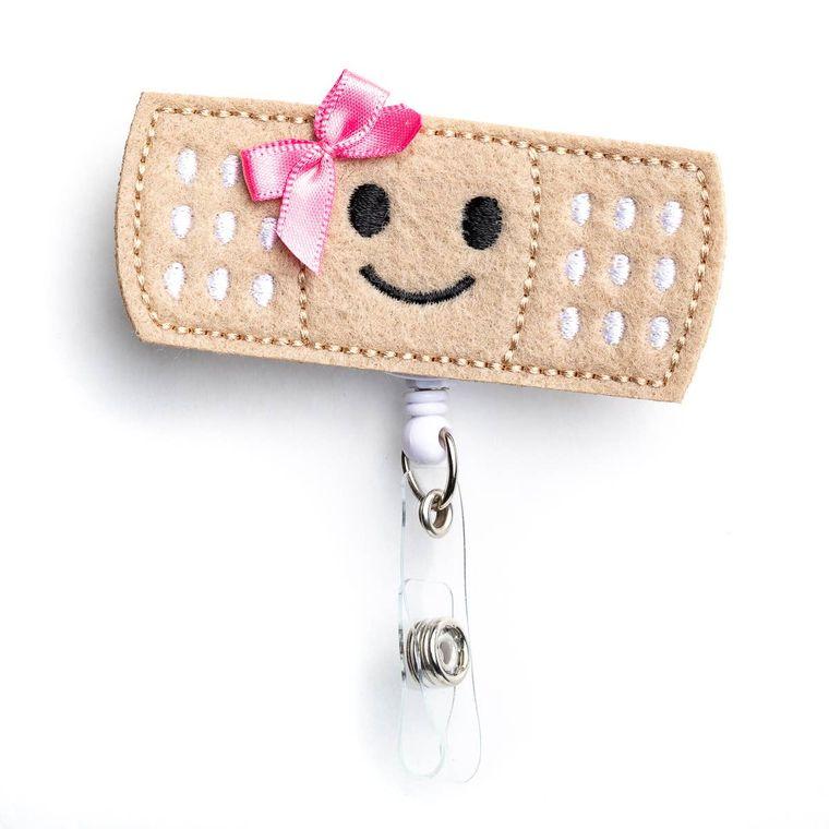 Girl Bandaid Badge Reel Holder
